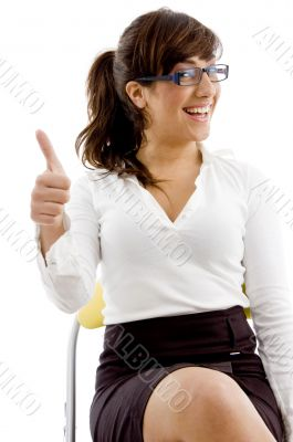 front view of smiling female with thumbs up
