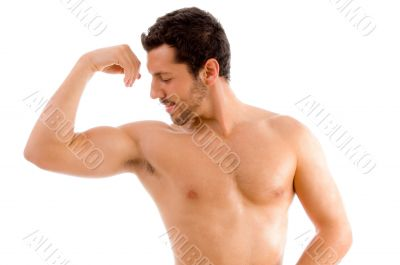 strong man looking his muscles