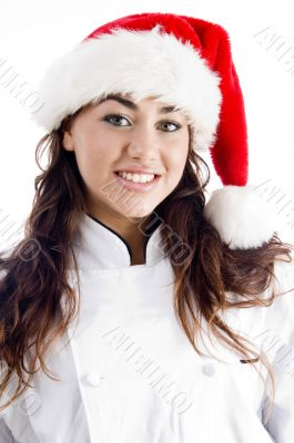 smiling chef wearing christmas hat