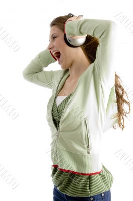 female shouting while listening to music