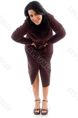 bending woman wearing overcoat on white background