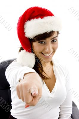 smiling attorney in christmas hat pointing at came