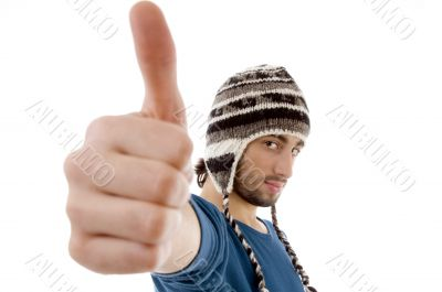 handsome guy wearing woolen cap with thumbs up