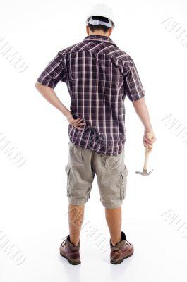 back pose of worker holding hammer