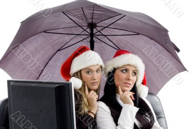 young executives posing together in christmas hat