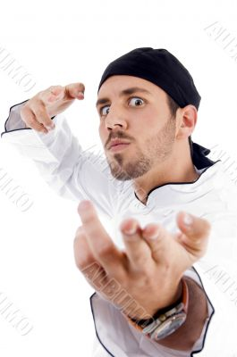 angered male chef posing with karate