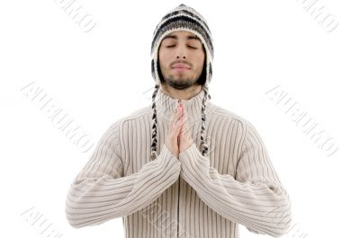 young guy praying with joined hands
