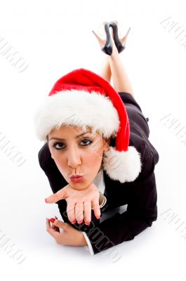 employee with christmas hat giving flying kiss