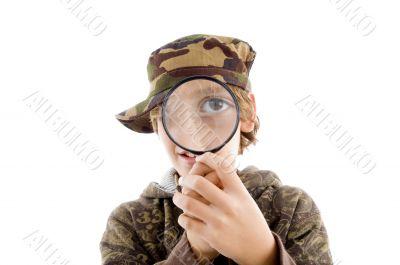 portrait of little boy looking through lens