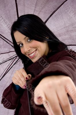 front view of pointing woman holding umbrella