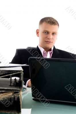 businessman with laptop and files