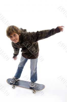 front view of boy riding skate