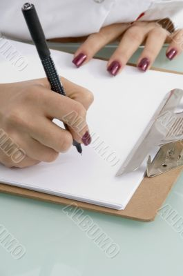 writing hands with notepad