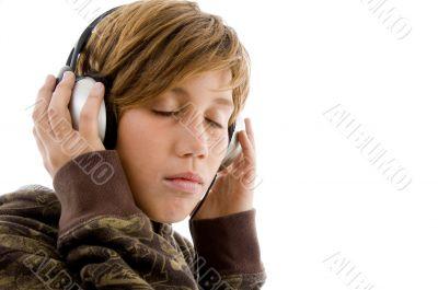portrait of teen listening music