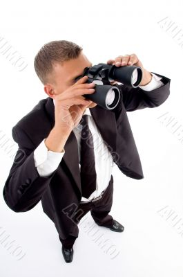 young accountant looking through binoculars