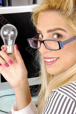 side pose of woman holding bulb