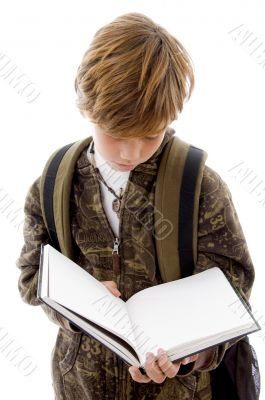 front view of school child reading