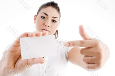 attractive model pointing towards business card