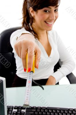 smiling woman showing measurement tape