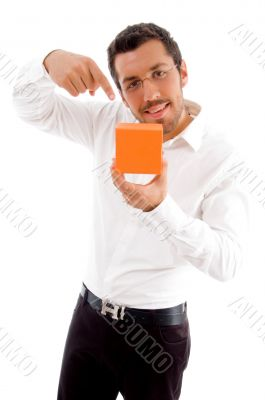 young man indicating towards jewellery box