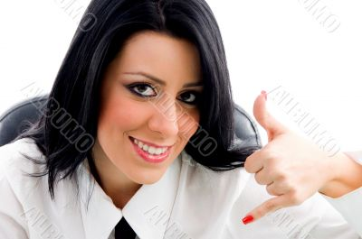 female showing telephonic hand gesture