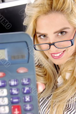 close view of woman showing calculator