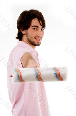 back pose of man with paint roller