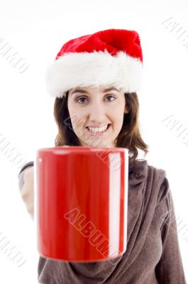 female in christmas hat showing her coffee mug