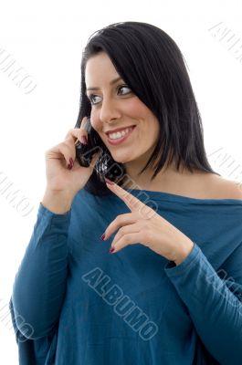 smiling female talking on mobile on white backgrou