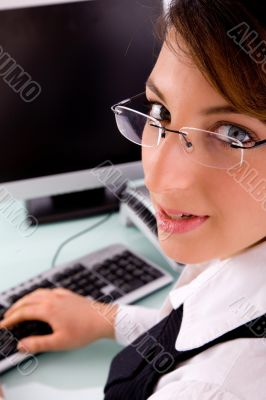 side view of corporate woman looking at camera