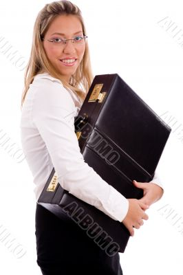 side view of smiling employee holding briefcase