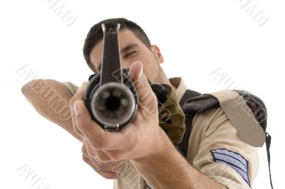 portrait of young soldier aiming