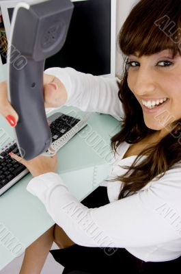 happy female attorney holding phone receiver