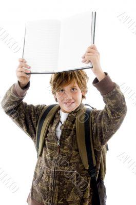 school boy at camera showing copy space