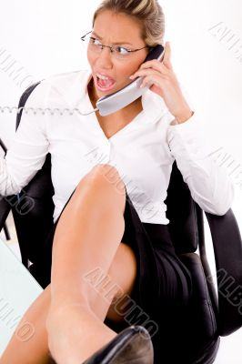 top view of smiling employee busy on phone