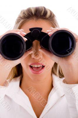 young businesswoman looking through binocular