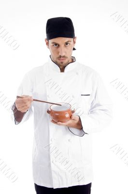 professional chef holding bowl and chopstick