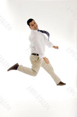 businessman leaping in mid of air