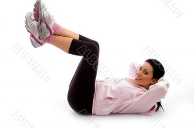 side view of smiling exercising female