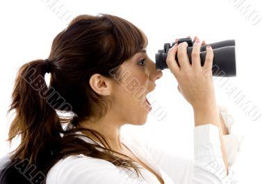 shocked female viewing through binoculars