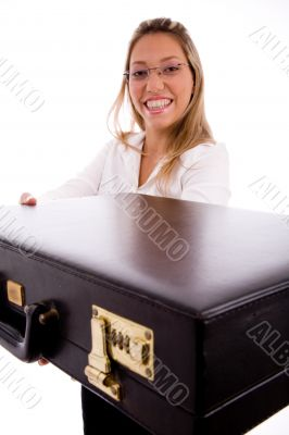 side view of smiling lawyer showing briefcase