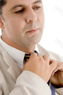 professional man adjusting his tie