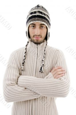 handsome man wearing woolen cap and posing