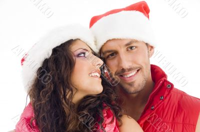cheerful young couple wearing christmas hat
