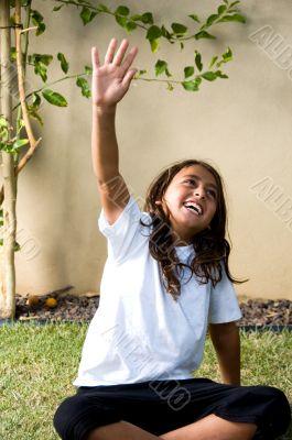 young boy raising his arms