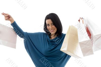 portrait of cheerful model with carry bags