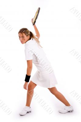 side view of tennis player ready to hit the ball