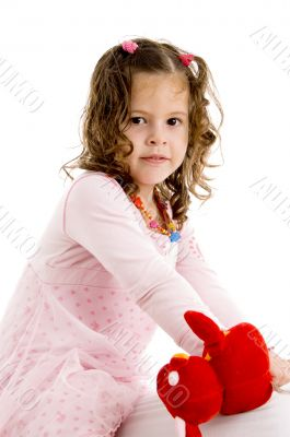 adorable girl posing with her toy