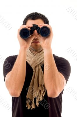young male holding binocular