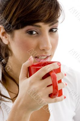 front view of female accountant drinking coffee